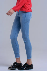 Light blue skinny jeans with fringes