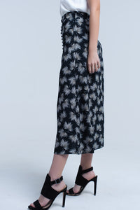 Midi black skirt with button detail and leaf print