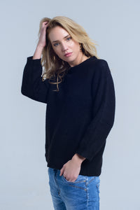 Black knitted crew neck sweater
