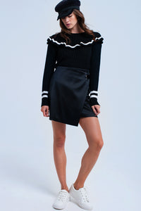Cable knit black sweater with ruffles