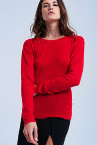 Red sweater with little cuts
