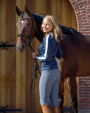 QHP Loureen horseback riding pants for the fashion forward equestrian. These light-blue pants are the perfect addition to any horseback riders wardrobe.