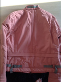 Anky technical solution jacket for the stylish equestrian and horseback rider. This light pink jacket is great for horseback riders on the go.