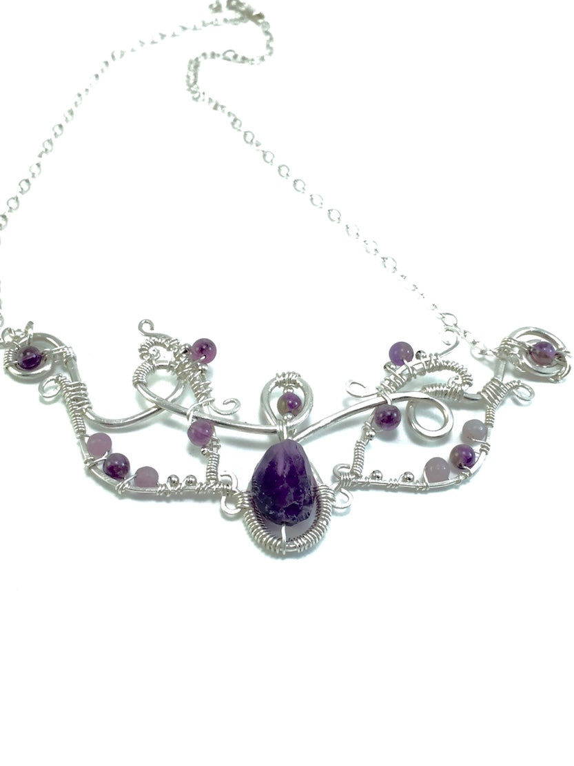 Amethyst lilac wire wrapped sterling silver necklace, large purple stone in center surrounded by small purple and light purple stones, sterling silver chain, handcrafted artisan jewelry, Grace Andersen Designs
