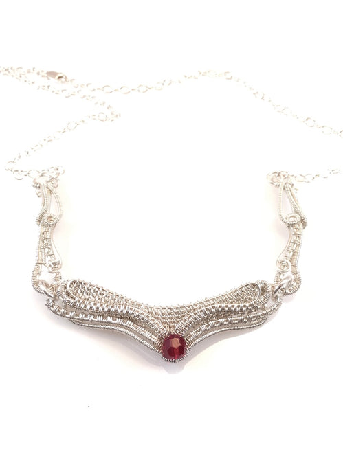 Linked red Swarovski sterling silver necklace, wire wrapped with red Swarovski crystal as focal point, first two links of chain are detailed wire wrapping, handcrafted artisan jewelry, Grace Andersen Designs