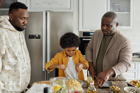 Family cooking together; photo courtesy of Pexels