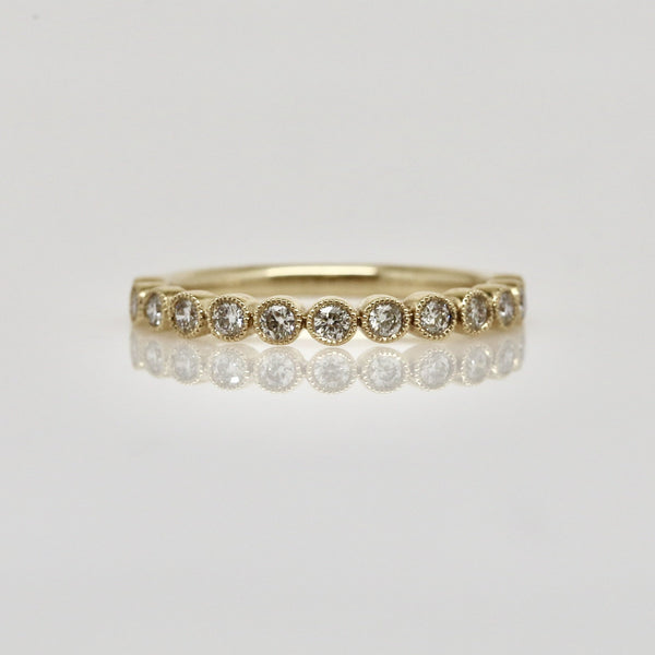 14 Karat Bezel Set Diamond Ring with Milgrain