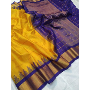 Handwoven pure Gadwal silk saree in yellow color with zari checks and wide zari border - Gadwal Silk Sarees