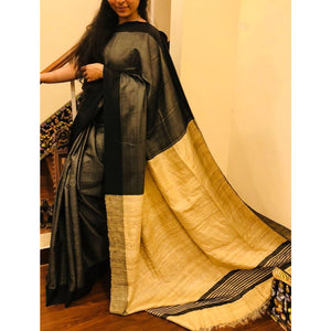 Handwoven pure Tussar silk saree with ghicha pallu in black and yellowish beige color - Tussar Silk Sarees
