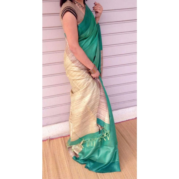 Handwoven pure Tussar silk saree with ghicha pallu in green and beige color - Tussar Silk Sarees