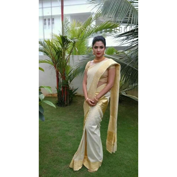 Kerala handwoven cotton plain settu mundu in off white color with wide golden zari border - Kerala Handwoven sarees
