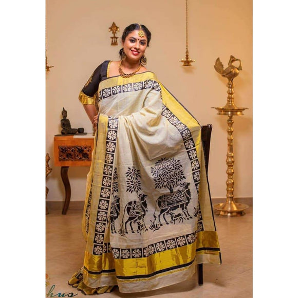 Kerala off-white with black golden zari border semi tissue handwoven and hand painted mural designed saree - Kerala Handwoven sarees