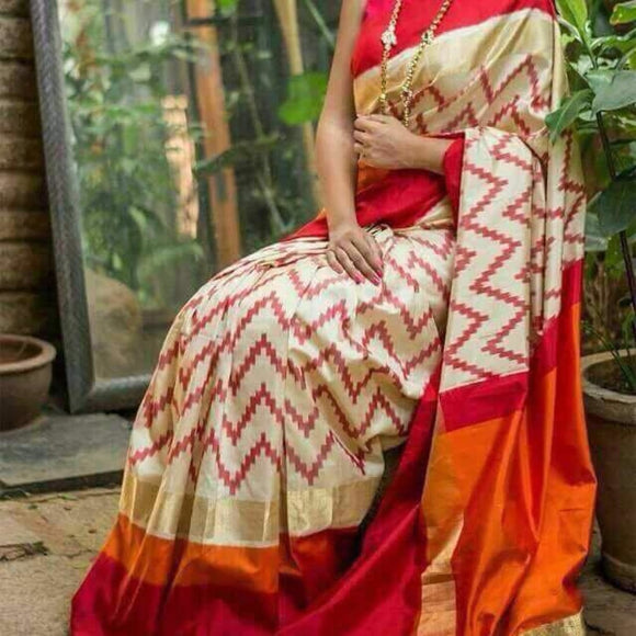Pochampally ikkat white with orange and maroon zari border handwoven pure silk saree - Pochampally Ikkat Silk Sarees