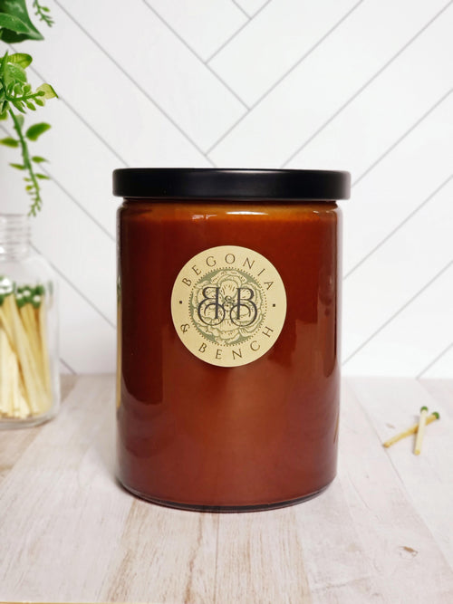 Premium Botanical Wax Candle. Signature Collection Candle in Coppertone, size Grand - with a Black Metal Lid.