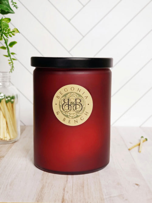 Premium Botanical Wax Candle. Signature Collection Candle in Red Velvet, size Grand - with a Black Metal Lid.
