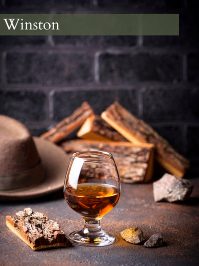 cedar wood backdrop with brown wool hat and a elegant whiskey glass for the scent Winston.