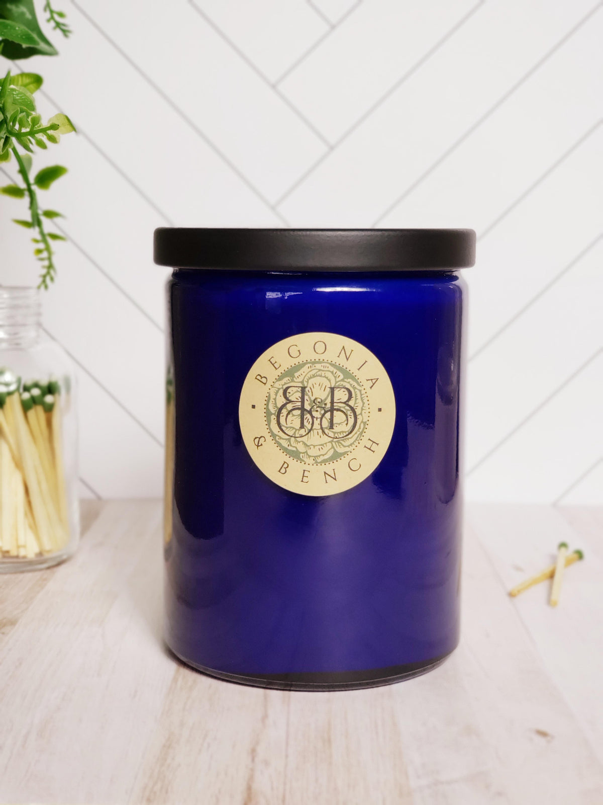 remium Botanical Wax Candle. Signature Collection Candle in Cobalt Blue, size Grand - with a Black Metal Lid.