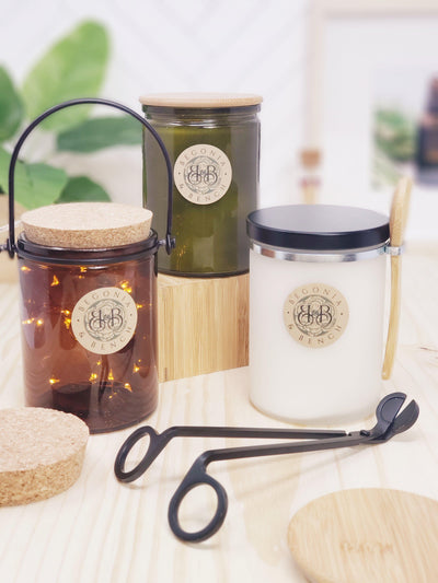 3 candles with cork topper, bamboo topper and black metal topper lids on grand size jar. Includes wick trimmer and jar hanger as accessories in the photo.