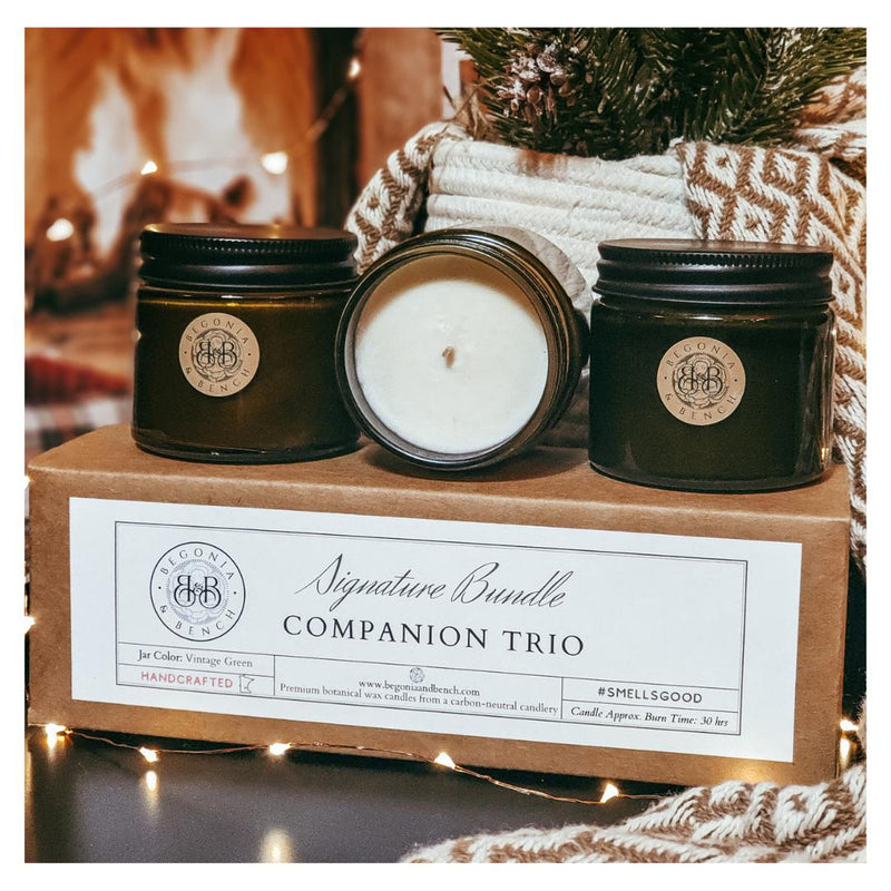 Our Companion Trio box set with three Companion candles sitting atop the box.