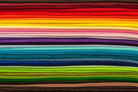 collection of textiles in rainbow colors