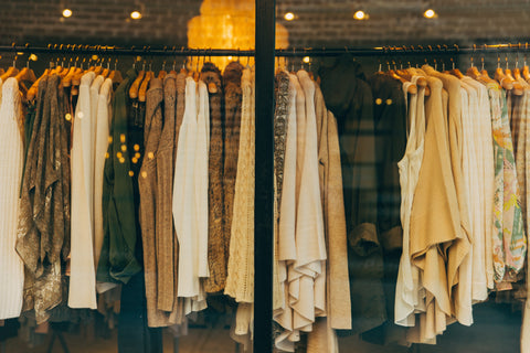 hanged clothes in warm earth colors typical for sustainable fashion