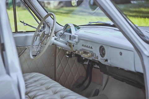 vintage car inside white classic