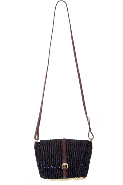 black and brown woven leather and raffla shoulder bag with flap closure