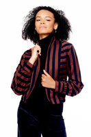 model with red and black striped jacket