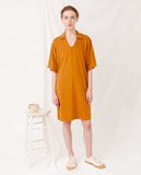baggy organic cotton dress in rust yellow v neck front
