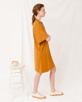 baggy organic cotton dress in rust yellow v neck side