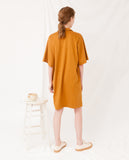 baggy organic cotton dress in rust yellow v neck back