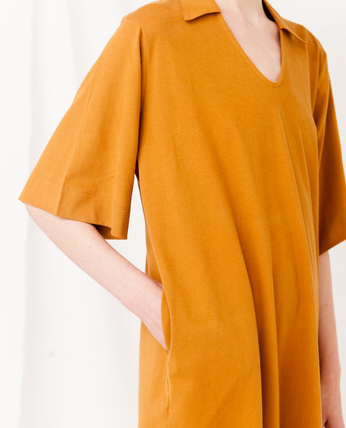 baggy organic cotton dress in rust yellow v neck zoom