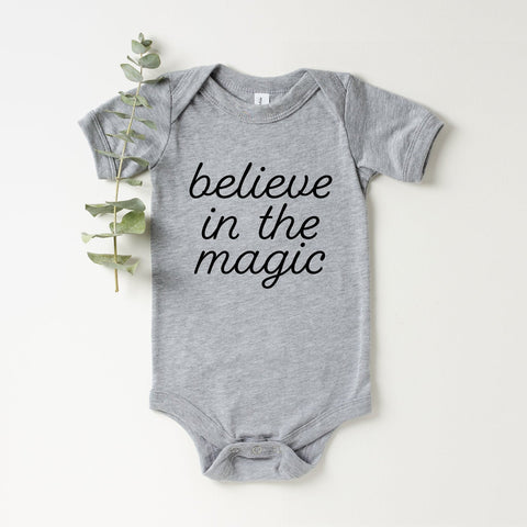 Believe In The Magic Onesie (Black Handwritten Text)