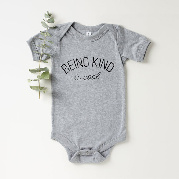Being Kind Is Cool Baby Onesie (Curved Black Text)