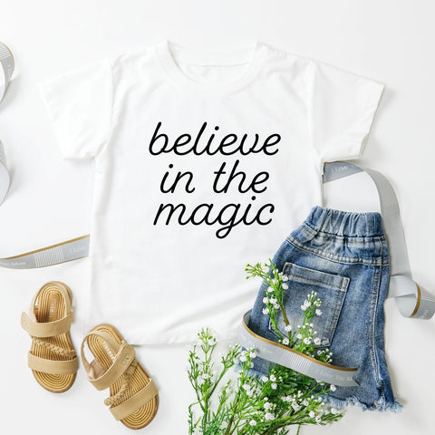 Believe In The Magic Baby T-Shirt (Black Handwritten Text)