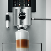 JURA 10 Bean to Cup Coffee Machine pouring a drink