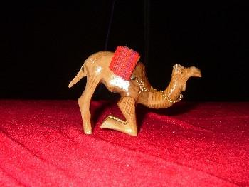 Hand Carved Olive Wood Statue: Kneeling Camel with Red Sadle