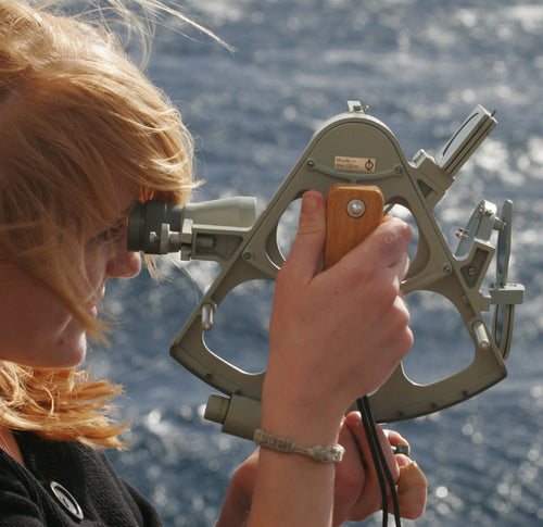 Anna learning to use a sextant on barque Europa. a noon sight will give you latitude. Learn Astro Navigation on the RYA Ocean Yachtmaster course with Classic Sailing