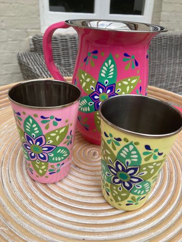 Hand painted tumbler with a colored leaf design
