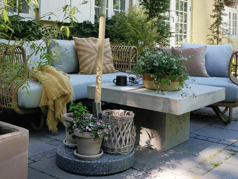 Comfortable outdoor lounge area with cosy lounge furniture