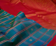 Peacock Blue Checked Kanchi Silk Saree With Pink Grand Border And Pallu