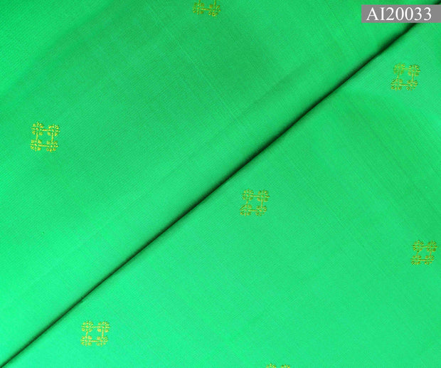 Lawn Green Kanchi Silk Fabric With Butta Design Highlights