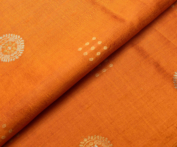 Orange Tussar Fabric With Silver And Gold Zari Butta Highlights