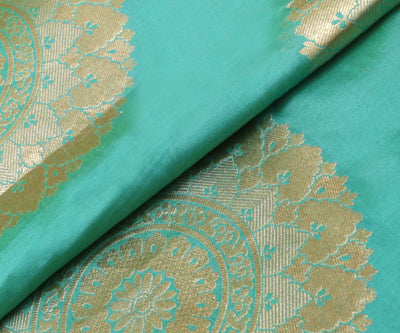 Aqua Blue Banarasi Silk Fabric With Large Zari Butta Highlights
