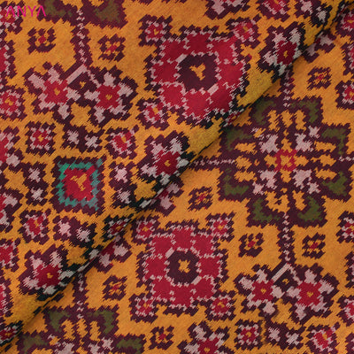 Dual Tone Mustard & Orange Patan Patola Silk Fabric With Border