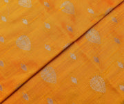 Fire Orange Tussar Fabric With Gold Zari Butta Highlights