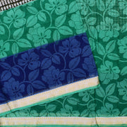 White Printed Bengal Cotton Saree With Seagreen And Blue Floral Printed Temple Zari Design Border With Seagreen Blouse