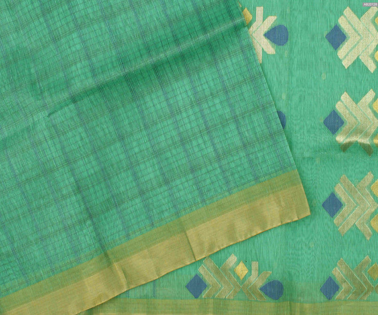 Turquoise  Linen Tussar  Saree With Gold Border and Silver and Gold Zari Butta Blouse