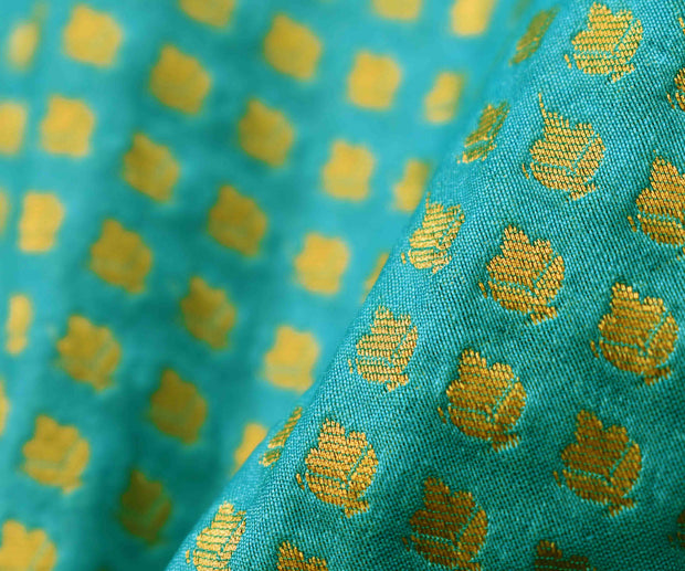Turquoise Semi Banarasi Silk Fabric With Floral Zari Butta Highlights