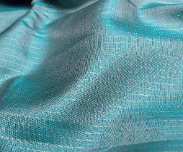 Baby Blue Kanchi Silk Fabric With Dotted Stripes Zari Design